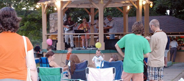 People enjoy Music in the Park at CPA Park last summer. The Eudora Chamber of Commerce will begin its second year of the event Saturday and the Downtown Eudora Business Association will have a bike show to showcase the downtown beautification projects completion.
