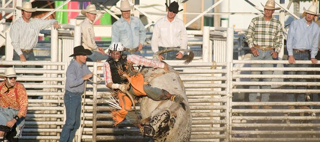 A bull rider competes Thursday at the Abdallah Shrine Rodeo.