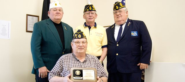 Dave Thomas, American Legion Department of Kansas commander, top left, Rick Edwards, ALDK first district commander, and Jim Timmons, past first district commander, present former Tonganoxie American Legion Post 41 Commander Jim Rogers with the legionnaire of the year award.  Edwards said Rogers was the first person ever in the first district to receive the honor. Rogers stepped down from his position after seven years as post commander.