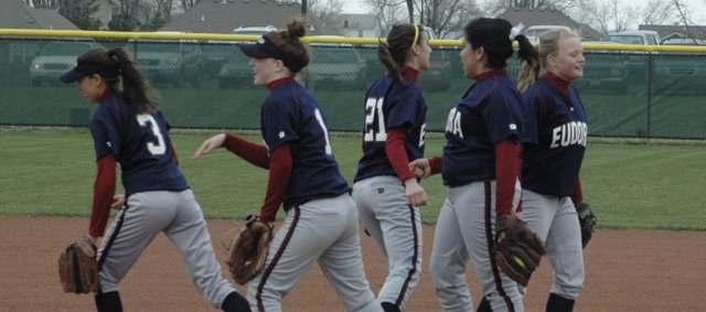 The Eudora softball team infielders break before the start of a game earlier this year. The Cardinals had just two seniors on the team but advanced to the second-round of regionals. Eudora finished the year 10-11.