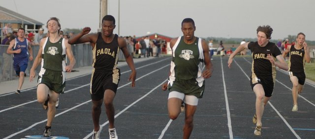 Jamel Townsend wins the boys 200-meter dash Friday at regionals in Santa Fe Trail. Jordan Riffel, left, placed third in the event and won the boys 100-meter dash. De Soto had several athletes qualify for this weekend's state track meet in Wichita.
