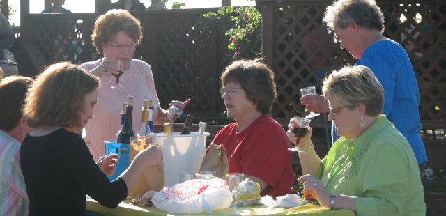 A group of women sample some wine during Thursday's Ladies Night at Holy-Field Vineyard and Winery.