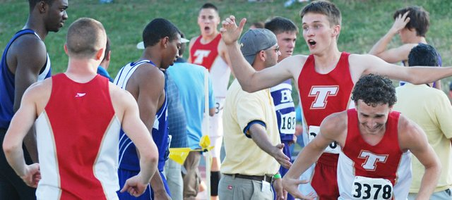 Tonganoxie High's 4x400 relay team reacts after winning a state championship on Saturday at Cessna Stadium in Wichita. Jeremy Carlisle (back turned), DJ Lindsay (background), David Powell and Bret Koch ran the 1600-meter race in 3:23.5, a THS record.
