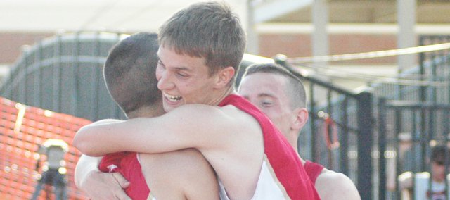 David Powell hugs DJ Lindsay moments after Tonganoxie won the state championship in the 4x400 relay race on Saturday in Wichita.