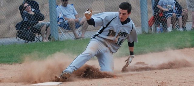 Eric Seymour slides across the plate against Mill Valley earlier in the season. The Wildcats began the year 1-4 before a winning streak advanced them into the second round of regionals. The Wildcats ended the year 12-10 and will return several starters next year.