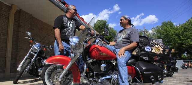 John Jaycox and Tim Revelle, both of St. Louis, chat recently at Riverfront Harley Davidson in North Lawrence. They both plan to take part in this week's Kansas Harley Owners Group 2009 rally.
