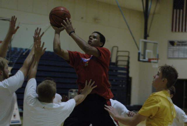 Christian Richardson drives to the lane and puts up a shot at the Eudora boys basketball camp last week.