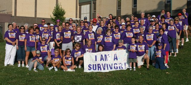 Cancer survivors pose for a photo during last year's Relay for Live survivor rally.