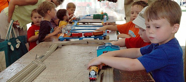 Beck Rettenmaier4, from Leawood, plays with a Thomas the Tank Engine replica in one of the tents during Saturday's Thomas event at the Midland Railway.