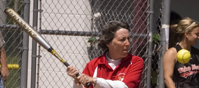 Diane Titterington, pictured hitting ground balls before a game in this Mirror file photo, did not have her coaching contract renewed by the Tonganoxie school board at its June 8 meeting.