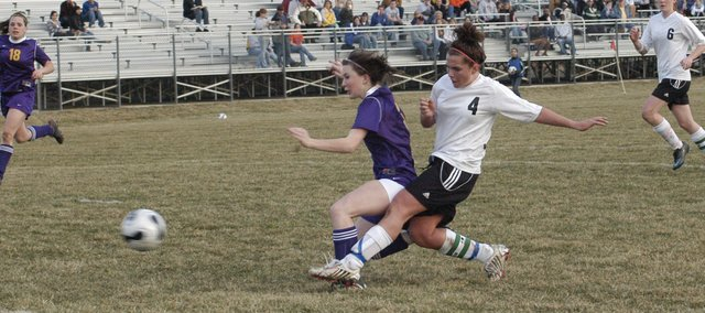 Danielle Price battles for the ball earlier this season. Price, senior, was a first team all-league and second team all-state performer this year for the De Soto girls soccer team. The Wildcats went 11-6-1 and advanced to the second round of regionals.