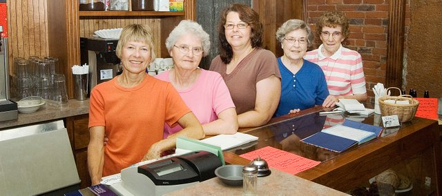 The staff of Pammy Sue's bakery and restaurant in Tonganoxie will be serving up food for the final time Friday. Pam Phillips, middle, who owns the establishment, decided it was time to retire, citing the economic downturn as the deciding factor. Pictured from left, are Jeanie Williams, Carolyn Kraus, Phillips, Orvella Schultz and Mary Theno.