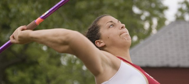 Roni Grizzle, Tonganoxie High senior, was named the Lawrence Journal-World's All-Area Girls Track Athlete of the Year for 2009. Grizzle, who will throw for the University of Nebraska next year, was second in the shot put and third in the javelin at the 2009 Class 4A state meet in Wichita.