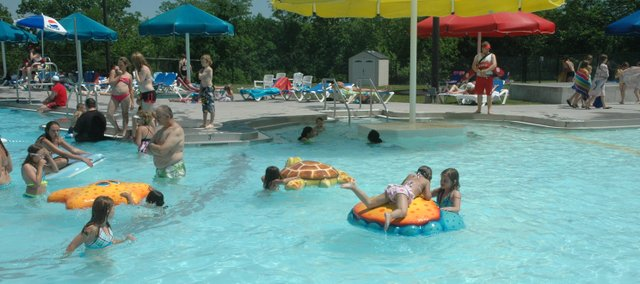 People swim at the Bonner Springs Aquatics Park to get some relief from the heat.