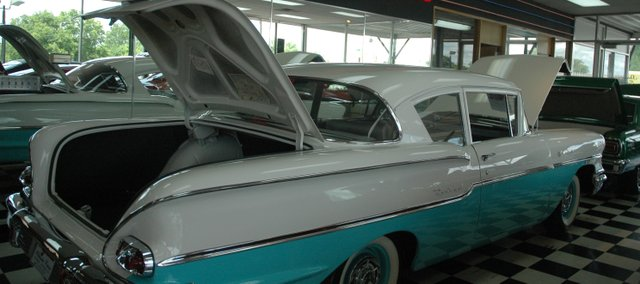 "This 1958 Chevrolet Del Ray ""Fuelie"" stands proudly in the showroom at Wagner's Auto Body and Sales, Inc. Features of the car include a 4-speed transmission and a correct air cleaner and distributor. The Del Ray has low mileage and sells for $60,000. Willie Wagner has been selling  classic cars such as this one since 1980 and sells about 125 cars in a good year."