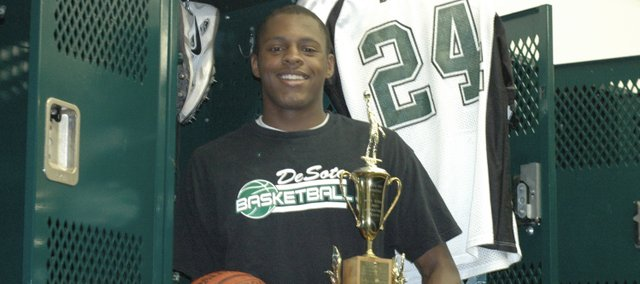 Jamel Townsend is The De Soto Explorer's 2008-2009 Male Athlete of the Year. Townsend was a three-sport star in football, basketball and track. Townsend was an all-league selection in football at wide receiver, defensive back and punter. Townsend was a first team all-league basketball player and finished first in long jump at the state track meet. Townsend was also given the school's Most Inspirational Award.