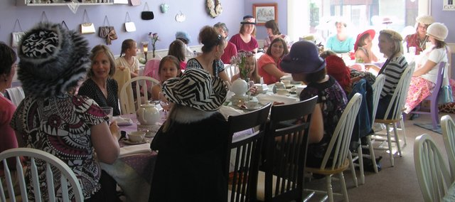 Madame Hatter's Tea Room, in Eudora, is the site of a Brownie troop mother-and-daughter tea. Madame Hatter's will be moving in July to Bonner Springs.