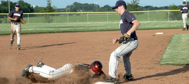 Zach Bryant forces out a Burlington runner at third base. Bryant was the starting pitcher in game one of the doubleheader and was relieved in the fourth inning.