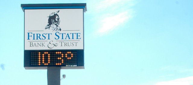 The electronic sign at the First State Bank & Trust, 400 Bury St., shows an air temperature of 103 degrees Fahrenheit on July 21, 2008.