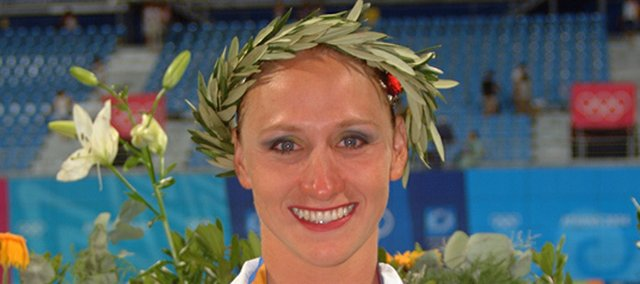 Becky Tomsic, who won a bronze medal at the 2004 Olympics as a member of the U.S. synchronized swimming team, will teach classes on the sport in Shawnee.