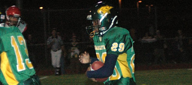 Bruce Tyner, a 2008 Basehor-Linwood High School graduate, carries the football during a game against Lansing as a BLHS junior. Although track was his best sport, Tyner made his greatest impact on the football field. He spent much of his high school track career injured, but he gained a second chance when he walked on to the track team at the University of Kansas.