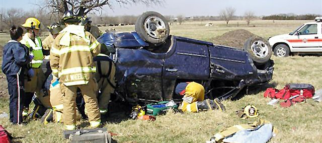 Eudora Community EMS responders work on a rollover accident on south County Road 1061. Eudora EMS had one vehicle and supplies redistributed to the Eudora Township Fire Department in an EMS restructuring agreement Douglas County Commissioners signed June 15.
