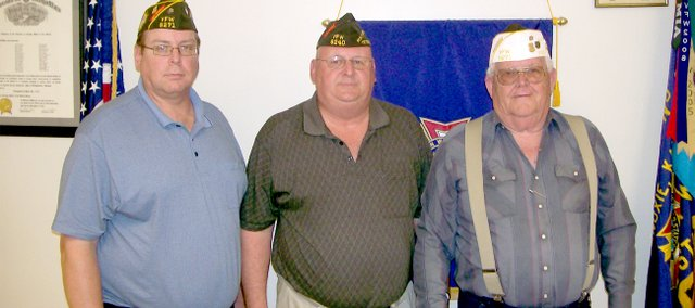 VFW Post 9271 incoming commander Dan Hopkins, left, stands with Barry Hoffman, former national sergeant of arms, and outgoing commander Elmer Tanking.