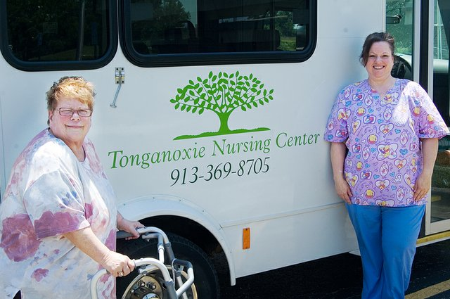 Pattie Frost, left, rural Tonganoxie, stayed at Tonganoxie Nursing Center after undergoing hip replacement surgery at Providence Medical Center. At right is Carrie Anderson, director of therapy at the nursing center.