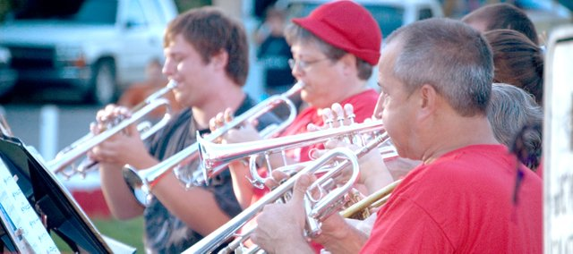 Trumpet players, from left, Geoffrey Towns, Moya Peterson and Paul Mast play during a song at the community band concert June 30 in VFW Park in Tonganoxie. For more coverage, see pages 8 and 23.