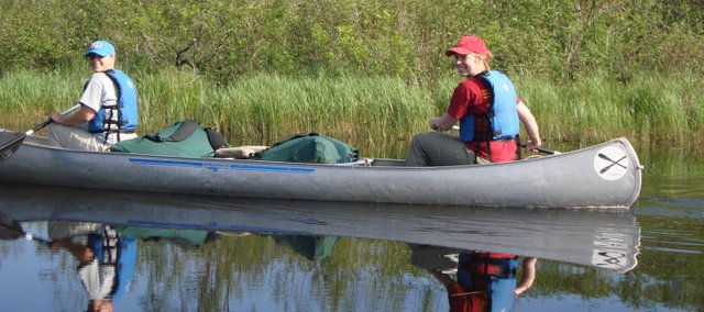 Jennifer Rockers, left, and Molly Dykman, teachers at Delaware Ridge Elementary paddle a canoe during an Outward Bound program they participated in June 14-21. Another teacher, Natalie Ball, also attended the program, which was in the Boundary Waters of Minnesota.