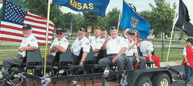 Members of the Basehor Veterans of Foreign Wars Post 11499 ride on a float during Basehor Gold PRIDE's annual Fourth of July celebration. In addition to the parade, there were games, a performance from the Stranger Creek Band and a fireworks display.