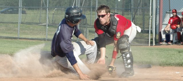 Chase Brecheisen is tagged out at the plate in Eudora's first game against Ottawa Wednesday at Eudora. Eudora was swept by the Cyclones, 17-9 and 4-1.