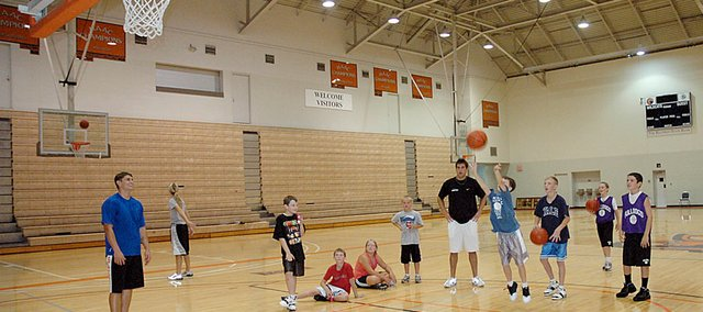 Participants at the Rick Weaver summer basketball camp compete in a free throw contest Tuesday.