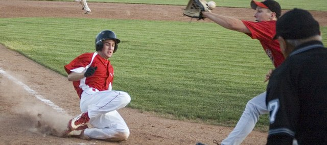 Corey Klinkenburg scores on a wild pitch to give Tonganoxie an early lead in its 8-6 victory over Geiger on Saturday night at Leavenworth County Fairgrounds. The win was Post 41's first game in the Post 23 League tournament, which will continue the next few days in Leavenworth.