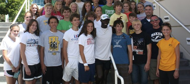 Members of the De Soto and St. Thomas Aquinas cross country teams are pictured with Olympian Lopez Lomong at the United States Olympic Training Center in Colorado Springs, Colo. The De Soto runners trained and saw the sights during their five-day trip last week.