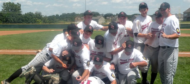 Members of K.C. Varsity Post 199 have a dogpile after winning the Class A Zone Tournament on Sunday at Piper High School. The team defeated Bishop Miege once and Olathe South twice along the way to winning the championship. Post 199 will take a 30-6 record into the state tournament beginning Friday in Emporia. The team is made up of players from Basehor-Linwood High School, Piper and Tonganoxie.