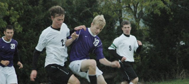 Jordan Slater (No. 2) battles for the ball in a match last season. Slater participates in soccer, wrestling and track at De Soto. He is also active in jujitsu during his free time.