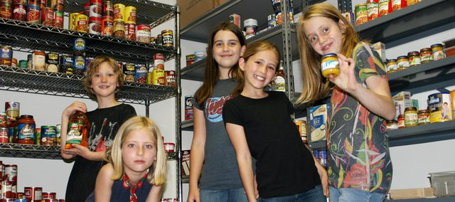 Vinland Elementary School students who helped deliver food  they'd gathered during a spring food drive are, from left, T.J. Hopper, Johanna Knowles, Hannah Upton, Filippa Knowles and Riese Wismer. They took the pickup load of food to the Community Food Pantry at the First United Methodist Church.