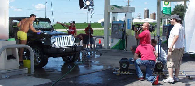 "Film crews tape a dream sequence for a music video at Lake Stop convenience store Sunday, July 19, 15621 158th St. The music video is for Pennsylvania-based country singer Raina Bauman's new single, ""Harley Man."""