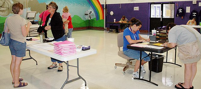 Baldwin Elementary School Primary Center employees set up their enrollment inside the building's multi-purpose room last year. The BESPC and all other district schools will enroll students from 9 a.m. to 1 p.m. and 3-7 p.m. on Tuesday.