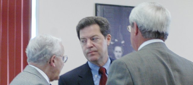 U.S. Sen. Sam Brownback, R-Kan. (center), visits with retired Lt. Gen. Robert Arter (left) and Leavenworth businessman Jerry Riling prior to a news conference in August in Leavenworth. Brownback and U.S. Reps. Lynn Jenkins and Jerry Moran were in town to sound the alarm against an Obama administration plan to move suspected terrorist detainees from Guantanamo Bay, Cuba, to Fort Leavenworth.