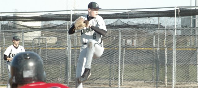 Daniel Peterson delivers a pitch this spring against Ottawa. Peterson, De Soto's ace, pitched 33 innings and notched 25 strikeouts this summer for the Wildcats and will return next spring to help give the team added depth.