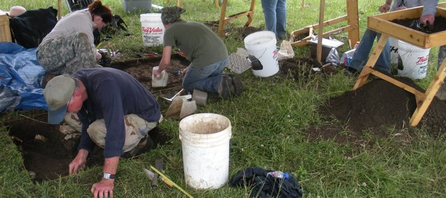 Archeology students dig in Bates County, Mo. The field class, through University of Missouri-Kansas City, was to determine the affects chronic violence had on people living in the area leading up to the Civil War. A Bonner Springs father-daughter duo took place in the dig.