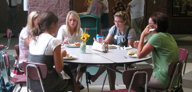 A group of teachers chats over lunch Thursday at the PRIDE luncheon.
