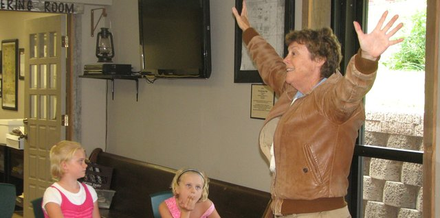 Ann Birney impersonates Amelia Earhart Thursday during a living history presentation at the Basehor Historical Museum.