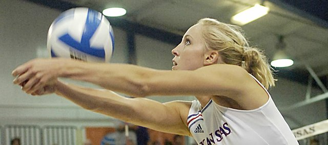 Emily Brown, a 2004 Baldwin High School graduate, volleys a serve during a match a couple of years ago when she played for the University of Kansas. Brown will be leaving next week to go play professional volleyball in Nantes, France.