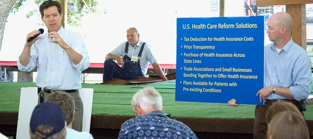 U.S. Sen. Sam Brownback, R-Kan., speaks to people gathered at a town hall meeting Tuesday at the Leavenworth County Fair in Tonganoxie. Brownback spoke with about 75 people in attendance at the meeting, which focused on health care, immigration and other issues.