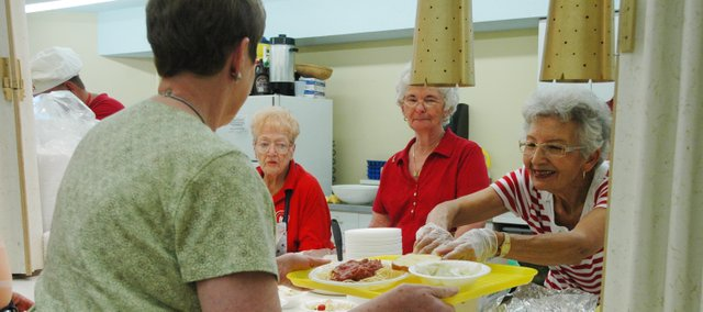 There's service with a smile at the Spaghetti Dinner.