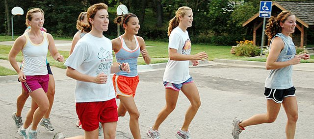 Members of the Baldwin High School girls' cross country team run near the park at 11th and High streets Tuesday morning. Pictured, from left, are Lauren Barnes, Heather Karlin, Sienna Durr, Connor Twombly and Julie Hill.