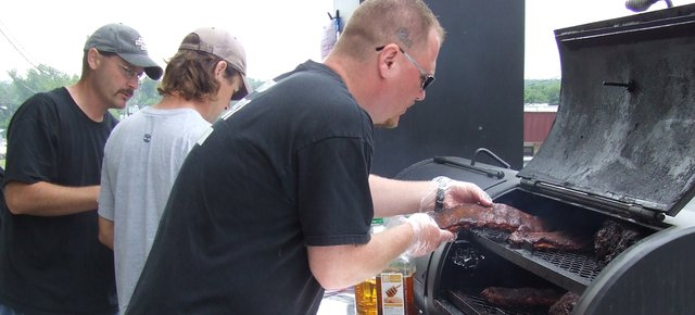 Contestants compete during last year's Tiblow Days barbecue contest. Among other growth seen within the Tiblow Days celebration, this year's barbecue competition will bring in more than twice the number of teams than competed last year.